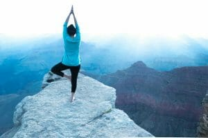 Focused girl exercising yoga in Grand canyon
